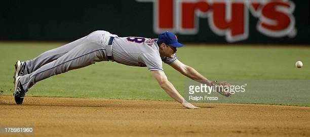 Second baseman Daniel Murphy of the New York Mets dives for a ground ball through the infield against the Arizona Diamondbacks during a MLB game at...