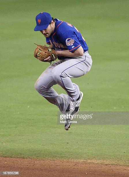 Second baseman Daniel Murphy of the New York Mets makes a play against the Miami Marlins in the ninth inning at Marlins Park on May 1 2013 in Miami...