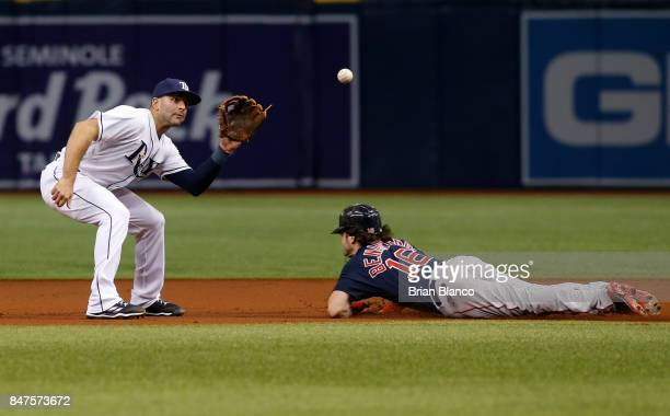 Second baseman Danny Espinosa of the Tampa Bay Rays catches Andrew Benintendi of the Boston Red Sox attempting to steal second base during the first...