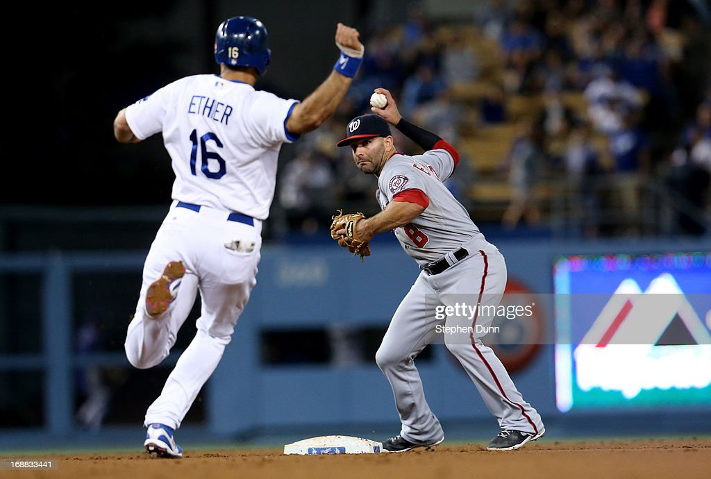 Second baseman Danny Espinosa #8 of the Washington Nationals throws to first to complete a double play after forcing out Andre Ethier #16 of the Los Angeles Dodgers in the sixth inning at Dodger Stadium on May 15, 2013 in Los Angeles, California.