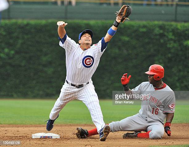 Second baseman Darwin Barney of the Chicago Cubs comes off second base to grab a throw from shortstop Starlin Castro as Edgar Renteria of the...