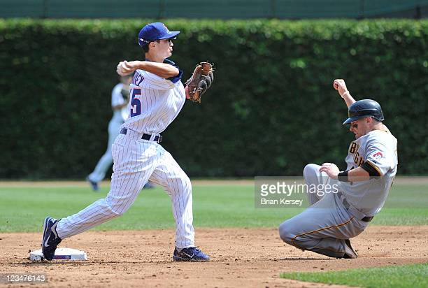 Second baseman Darwin Barney of the Chicago Cubs turns a double play as Ryan Doumit of the Pittsburgh Pirates slides into second base after Josh...