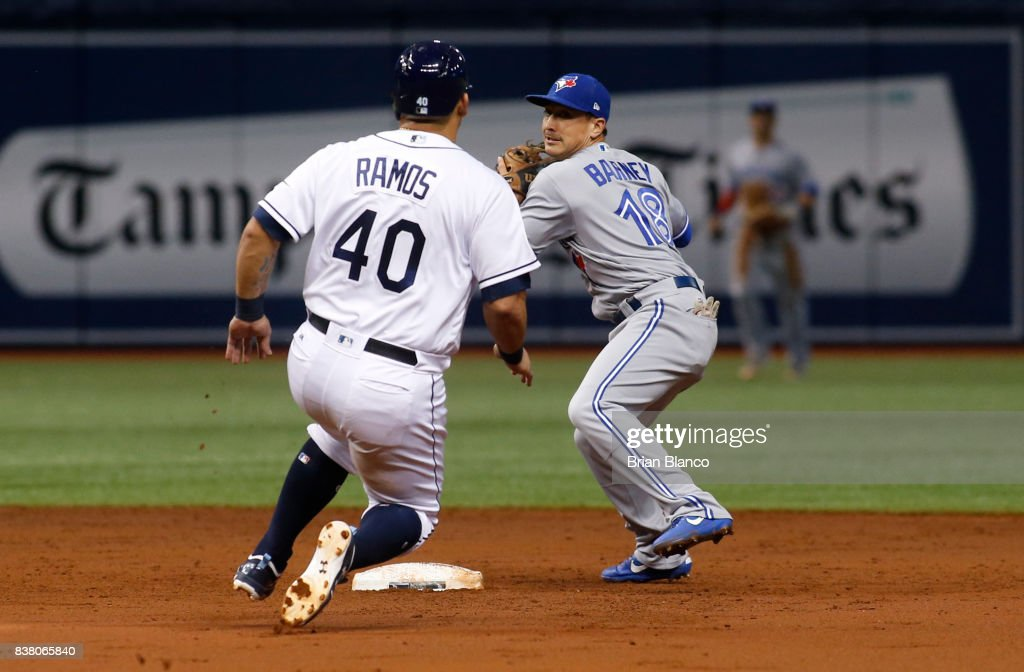 Second baseman Darwin Barney #18 of the Toronto Blue Jays gets the forced out at second base on Wilson Ramos #40 of the Tampa Bay Rays off of the fielder's choice by Adeiny Hechavarria #11 during the first inning of a game on August 23, 2017 at Tropicana Field in St. Petersburg, Florida.