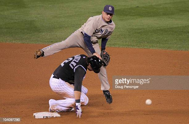 Second baseman David Eckstein of the San Diego Padres turns a double play over Troy Tulowitzki of the Colorado Rockies to end the fourth inning at...