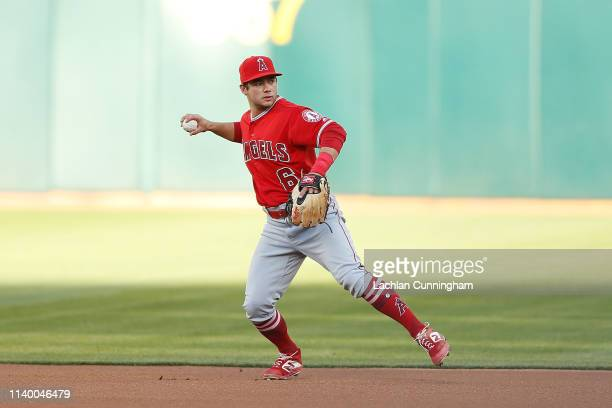 Second baseman David Fletcher of the Los Angeles Angels of Anaheim fields the ball in the bottom of the first inning against the Oakland Athletics at...