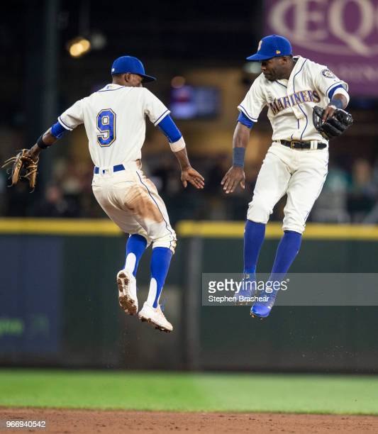 Second baseman Dee Gordon of the Seattle Mariners and Centerfielder Guillermo Heredia of the Seattle Mariners celebrate after a game against the...
