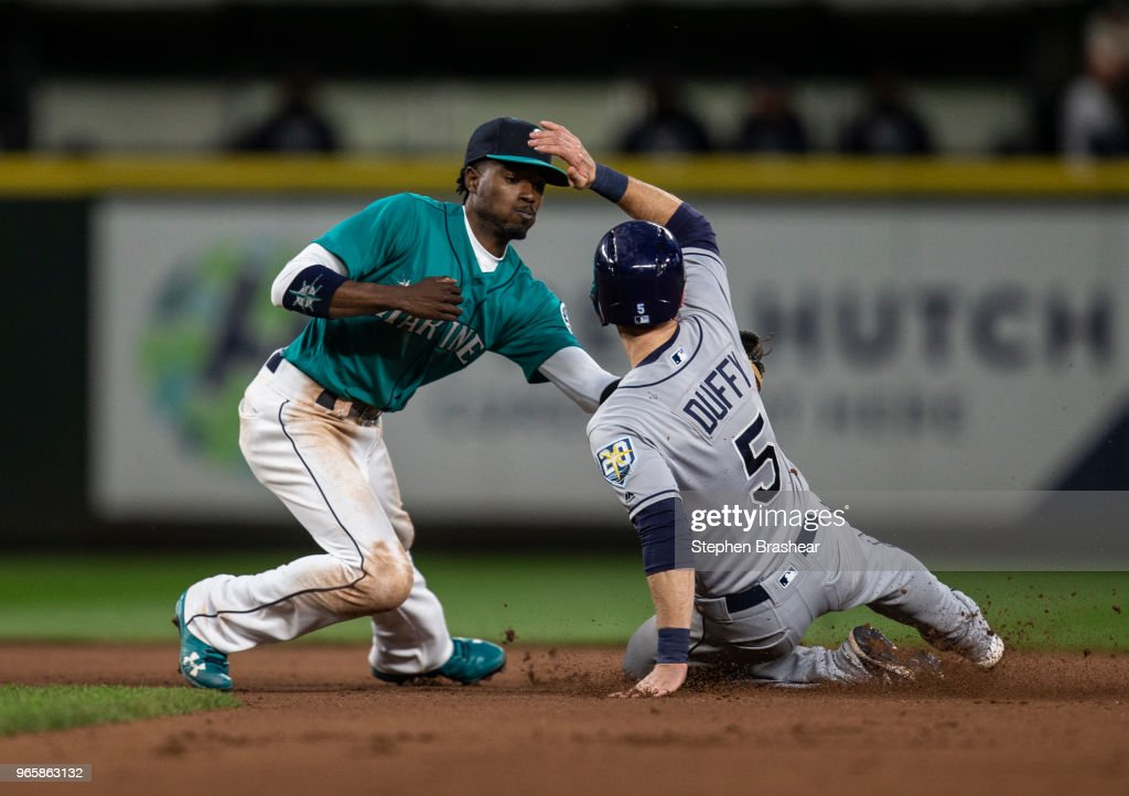 Second baseman Dee Gordon #9 of the Seattle Mariners tags out Matt Duffy #5 of the Tampa Bay Rays at second base to complete a double play after Brad Miller #13 of the Tampa Bay Rays during the seventh inning of a game at Safeco Field on June 1, 2018 in Seattle, Washington.