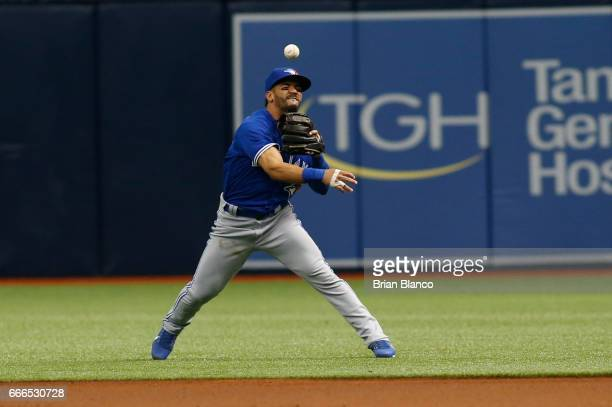 Second baseman Devon Travis of the Toronto Blue Jays makes an attempt to field the single by Kevin Kiermaier of the Tampa Bay Rays during the first...