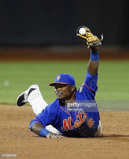 Second baseman Dilson Herrera of the New York Mets shows the ball to the umpire after tagging out Ian Desmond on a ball hit by Danny Espinosa during...