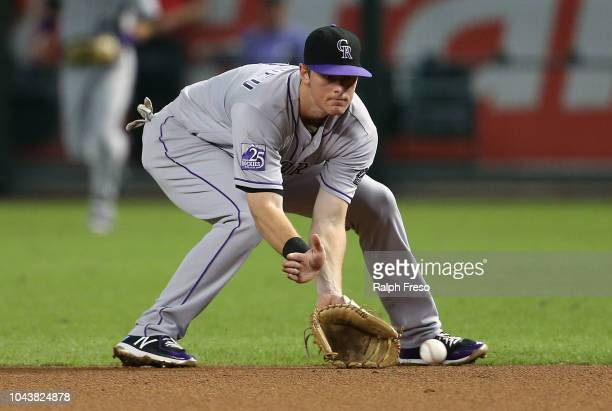 Second baseman DJ LeMahieu of the Colorado Rockies fields a ground ball against the Arizona Diamondbacks during the first inning of an MLB game at...