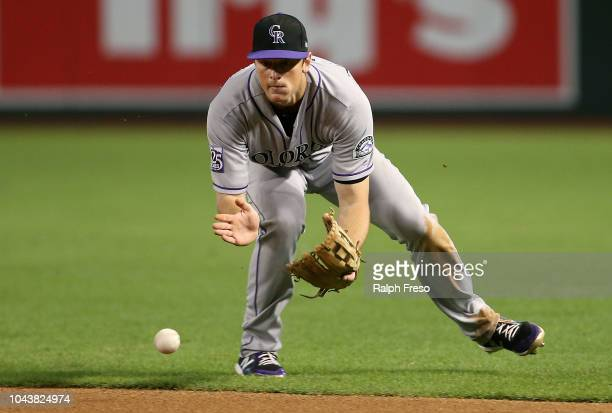 Second baseman DJ LeMahieu of the Colorado Rockies fields a ground ball against the Arizona Diamondbacks during the ninth inning of an MLB game at...