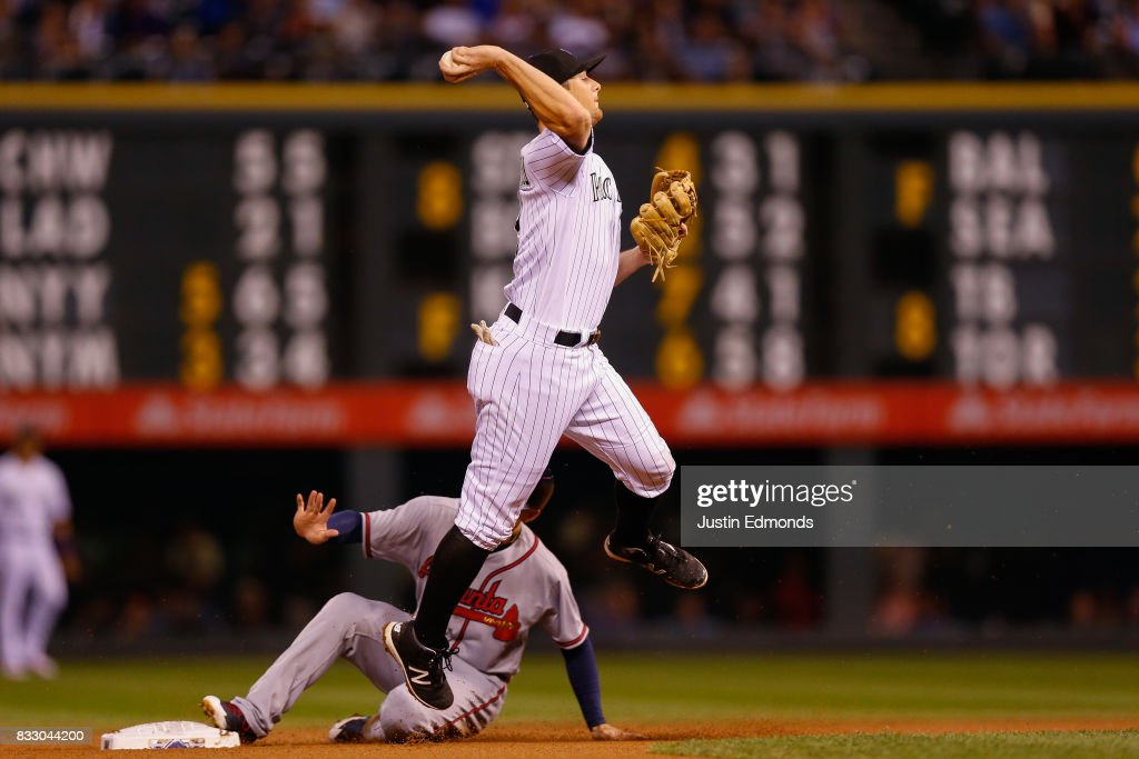 Second baseman DJ LeMahieu #9 of the Colorado Rockies throws to first to complete the double play for the first two outs of the fourth inning as Ender Inciarte #11 of the Atlanta Braves slides in at Coors Field on August 16, 2017 in Denver, Colorado.