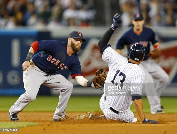 Second baseman Dustin Pedroia of the Boston Red Sox tags out Alex Rodriguez of the New York Yankees as he attempted to steal second base during the...