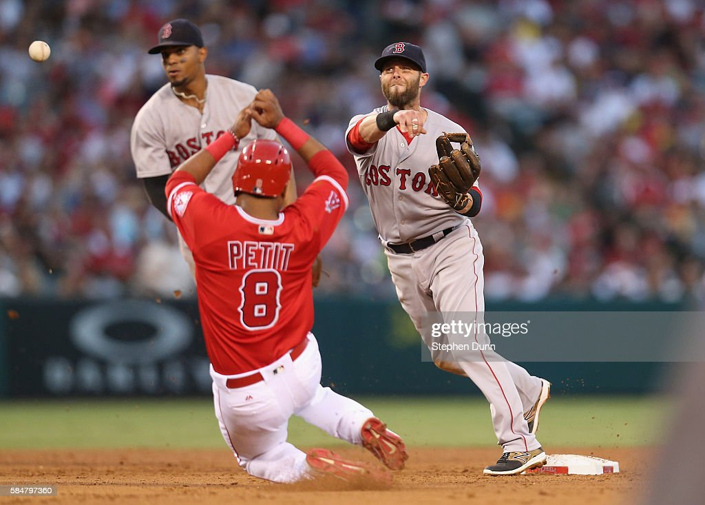 Second baseman Dustin Pedroia #15 of the Boston Red Sox throws to first to complete a double play after forcing out Gregorio Petit #8 of the Los Angeles Angels of Anaheim to end the fourth inning at Angel Stadium of Anaheim on July 30, 2016 in Anaheim, California.