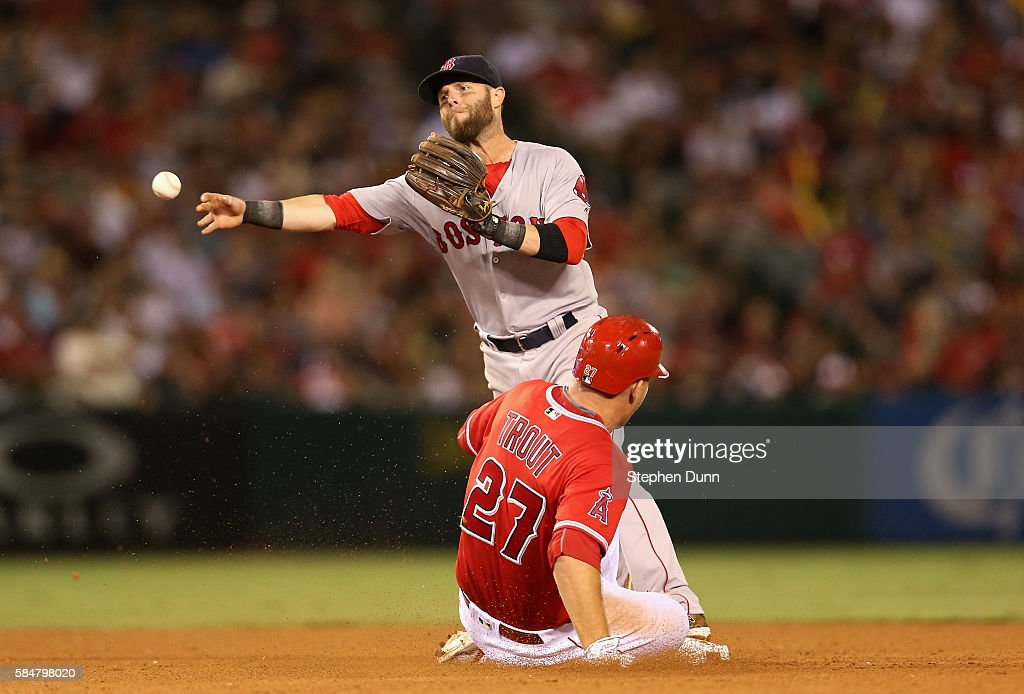 Second baseman Dustin Pedroia #15 of the Boston Red Sox throws to first to complete a double play after forcing out Mike Trout #27 of the Los Angeles Angels of Anaheim to end the seventh inning at Angel Stadium of Anaheim on July 30, 2016 in Anaheim, California.