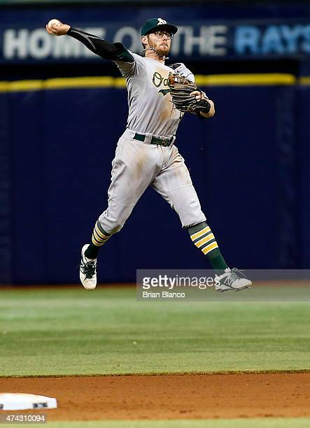 Second baseman Eric Sogard of the Oakland Athletics makes the throw to first base as he fields the ground out by James Loney of the Tampa Bay Rays...