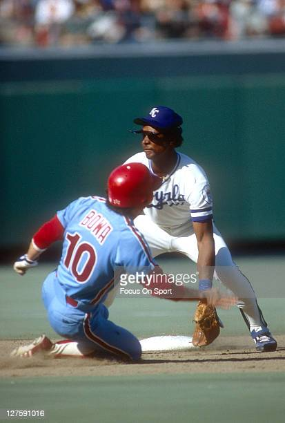 Second baseman Frank White of the Kansas City Royals waits on the as Larry Bowa of the Philadelphia Phillies slides into second base during the World...