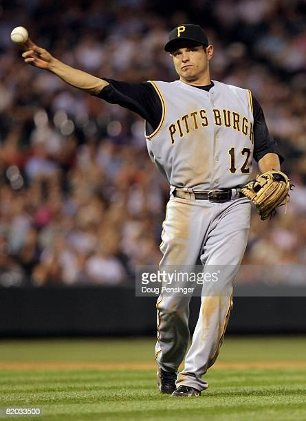 Second baseman Freddy Sanchez of the Pittsburgh Pirates throws out a runner against the Colorado Rockies at Coors Field on July 19 2008 in Denver...