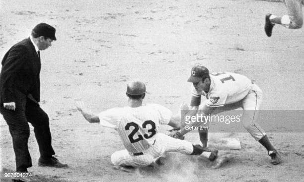 Second baseman, Glenn Beckert, tags out the Phillies Don Lock, who was attempting to steal during the first inning.