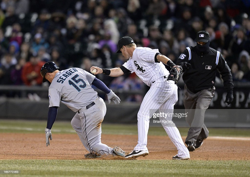 Second baseman Gordon Beckham #15 of the Chicago White Sox (R) tags out Kyle Seager #15 of the Seattle Mariners after Seager was picked off first base and caught in a run-down during the fourth inning on April 5, 2012 at U.S. Cellular Field in Chicago, Illinois.