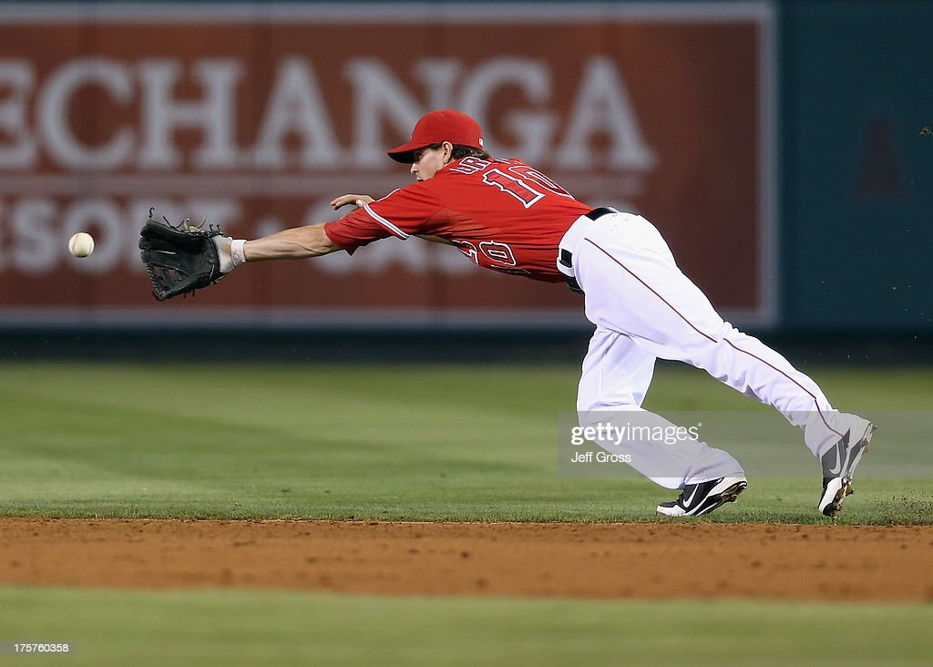 Second baseman Grant Green #10 of the Los Angeles Angels of Anaheim can't make the play on a ball hit by Mitch Moreland (not pictured) of the Texas Rangers in the third inning at Angel Stadium of Anaheim on August 7, 2013 in Anaheim, California.