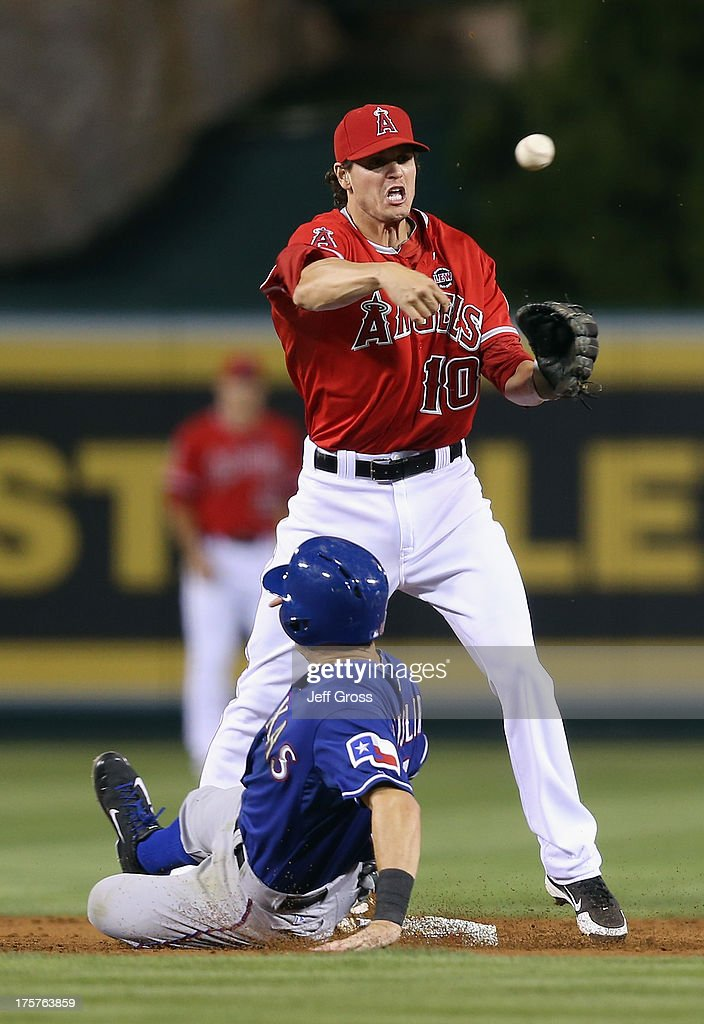 Second baseman Grant Green #10 of the Los Angeles Angels of Anaheim forces Ian Kinsler #5 of the Texas Rangers out at second in the third inning at Angel Stadium of Anaheim on August 7, 2013 in Anaheim, California.