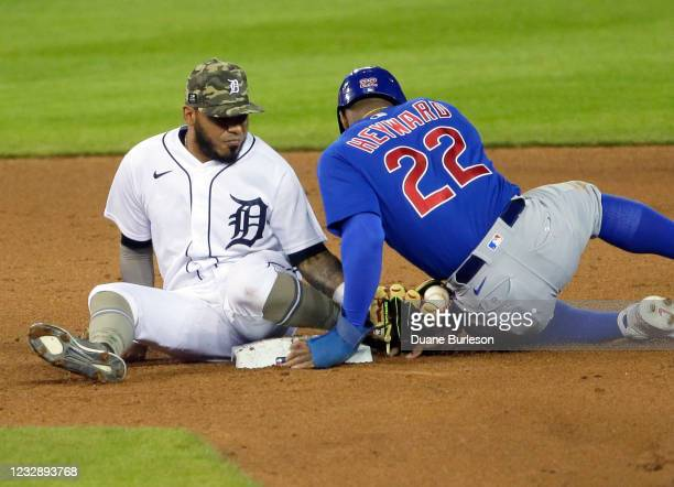 Second baseman Harold Castro of the Detroit Tigers holds onto the ball after tagging Jason Heyward of the Chicago Cubs after he attempted steal...