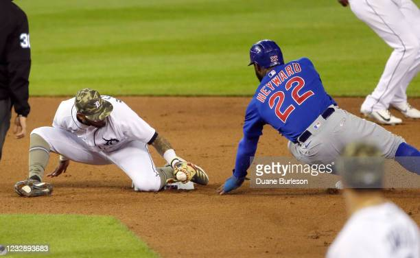 Second baseman Harold Castro of the Detroit Tigers tags out Jason Heyward of the Chicago Cubs as he attempts to steal second base during the game at...