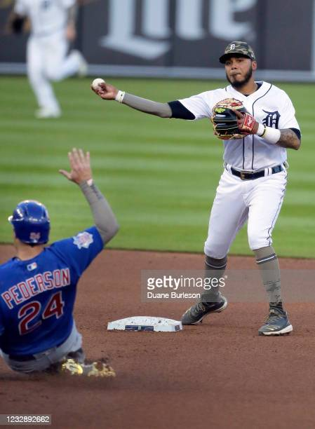 Second baseman Harold Castro of the Detroit Tigers throws to first after getting a force out on Joc Pederson of the Chicago Cubs during the fourth...