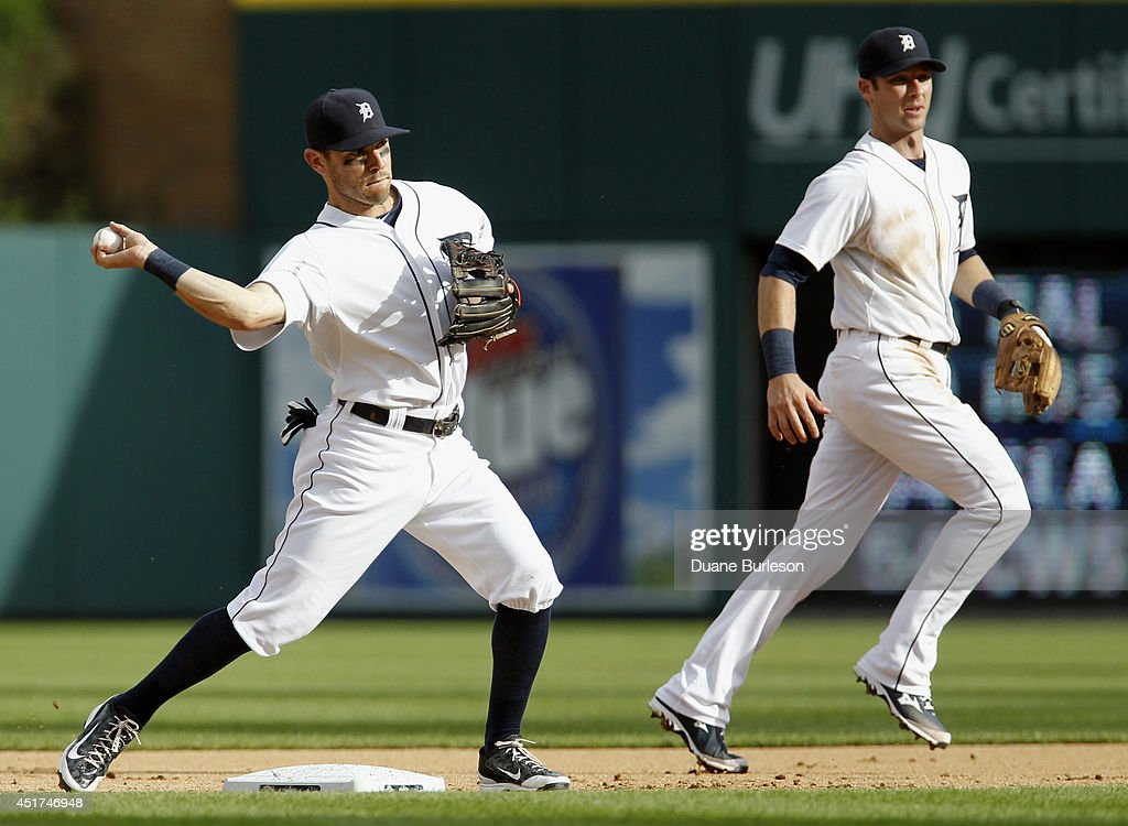 Second baseman Ian Kinsler #3 of the Detroit Tigers, left, turns the ball after it was thrown to him by shortstop Andrew Romine #27, right, to get a force out on Logan Forsythe of the Tampa Bay Rays during the eighth inning at Comerica Park on July 5, 2014 in Detroit, Michigan. Ryan Hanigan hit into the double play and was out at first base.