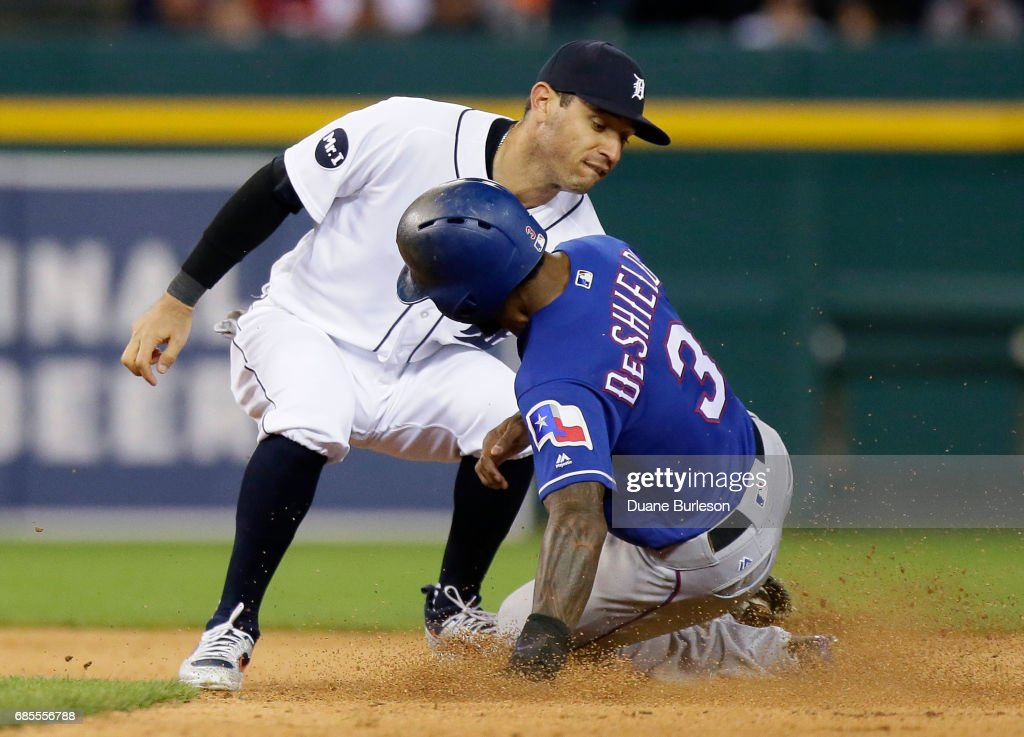 Second baseman Ian Kinsler #3 of the Detroit Tigers tags out Delino DeShields #3 of the Texas Rangers trying to steal second base during the seventh inning at Comerica Park on May 19, 2017 in Detroit, Michigan.