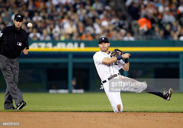 Second baseman Ian Kinsler of the Detroit Tigers throws out Ichiro Suzuki of the New York Yankees at first base during the seventh inning as second...