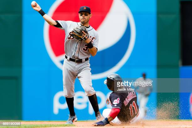 Second baseman Ian Kinsler of the Detroit Tigers throws out Yandy Diaz at first as Jose Ramirez of the Cleveland Indians is out at second for a...