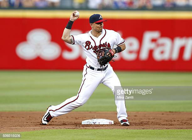 Second baseman Jace Peterson of the Atlanta Braves throws to first base for a double play in the first inning during the game against the Chicago...