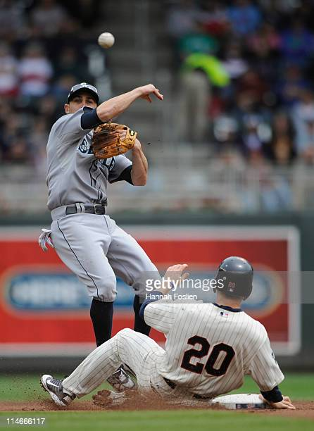 Second baseman Jack Wilson of the Seattle Mariners forces out Matt Tolbert of the Minnesota Twins at second base as Wilson turns a double play during...
