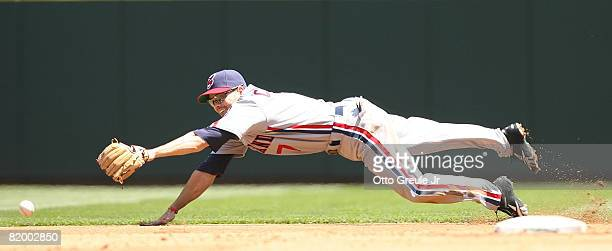 Second baseman Jamey Carroll of the Cleveland Indians dives for a double hit by Jose Lopez of the Seattle Mariners on July 19 2008 at Safeco Field in...