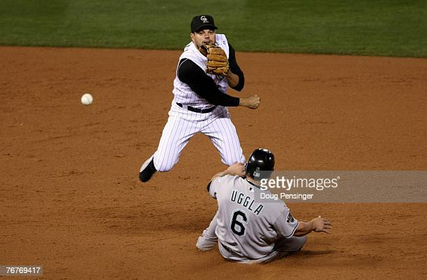 Second baseman Jamey Carroll of the Colorado Rockies gets a force on Dan Uggla of the Florida Marlins at second base but was unable to complete the...