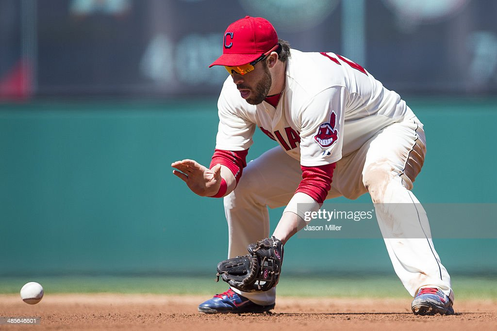 Second baseman Jason Kipnis #22 of the Cleveland Indians fields a ground ball hit by Dioner Navarro #30 of the Toronto Blue Jays during the third inning at Progressive Field on April 19, 2014 in Cleveland, Ohio.