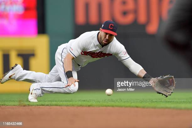 Second baseman Jason Kipnis of the Cleveland Indians makes a diving catch on a ground ball off the bat of Yordan Alvarez of the Houston Astros to end...