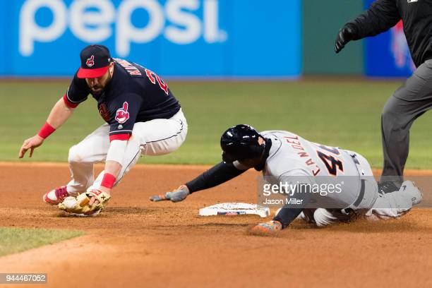Second baseman Jason Kipnis of the Cleveland Indians tries to make the tag on Jeimer Candelario of the Detroit Tigers on an RBI double during the...