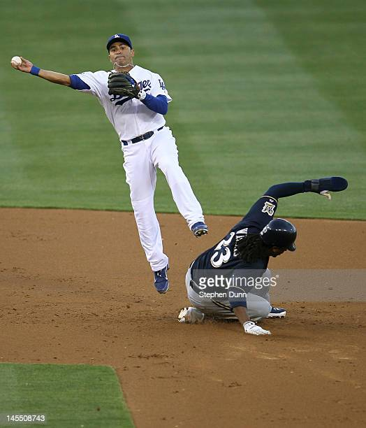Second baseman Jerry Hairston Jr #6 of the Los Angeles Dodgers throws to first after forcing out Rickie Weeks of the Milwaukee Brewers but can't...