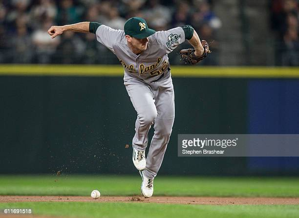 Second baseman Joey Wendle of the Oakland Athletics is unable to field a ball hit by Norichika Aoki of the Seattle Mariners during the first inning...