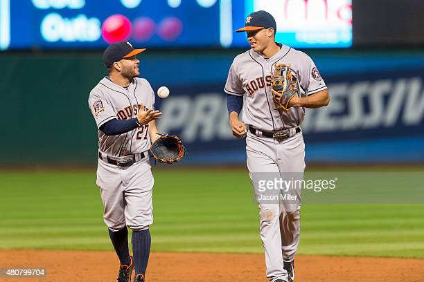 Second baseman Jose Altuve of the Houston Astros and shortstop Carlos Correa run off the field between innings against the Cleveland Indians at...
