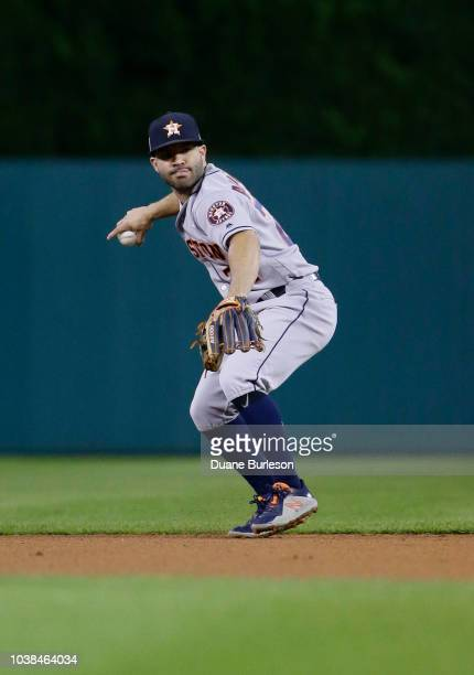 Second baseman Jose Altuve of the Houston Astros fields a grounder hit by Jim Adduci of the Detroit Tigers during the eighth inning at Comerica Park...