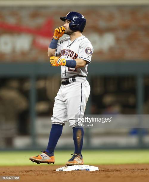 Second baseman Jose Altuve of the Houston Astros reacts after hitting an RBI double in the seventh inning during the game against the Atlanta Braves...