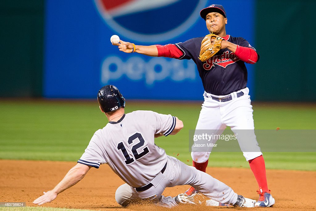 Second baseman Jose Ramirez #11 of the Cleveland Indians turns what would be a double play as Chase Headley #12 of the New York Yankees is out at second base to end the top of the eighth inning at Progressive Field on August 12, 2015 in Cleveland, Ohio.