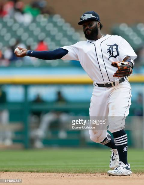 Second baseman Josh Harrison of the Detroit Tigers throws out Marcus Semien of the Oakland Athletics at first base during the sixth inning at...