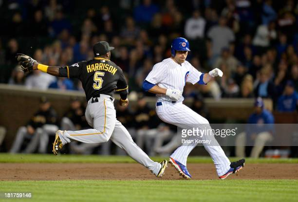 Second baseman Josh Harrison of the Pittsburgh Pirates chases down Nate Schierholtz of the Chicago Cubs after he was caught trying to advance to...