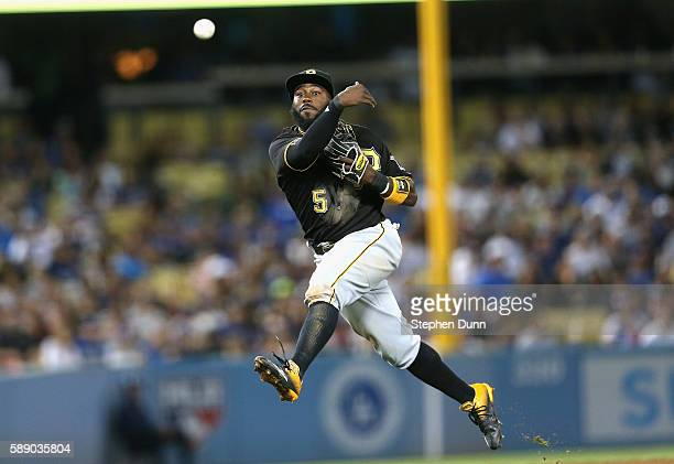 Second baseman Josh Harrison of the Pittsburgh Pirates throws to get Justin Turner of the Los Angeles Dodgers to end the seventh inning at Dodger...