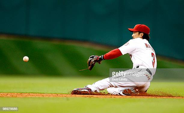 Second baseman Kazuo Matsui of the Houston Astros makes a sliding attempt to stop a ball hit by Chase Headley of the San Diego Padres in the fifth...